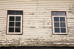 Windows and old wooden wall of cottage Stock Image