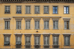 Windows on old yellow vintage building Royalty Free Stock Images
