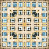 The windows on the old yellow wall with collapsed plaster - a pattern square from the photo royalty free stock image