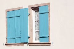 Windows with open and closed wooden shutters stock photography
