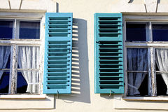 Windows with open shutters Stock Photo