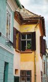 Windows with open shutters in a medieval house royalty free stock photo