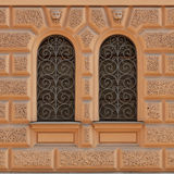 Windows with openwork grille in an old building Royalty Free Stock Photo