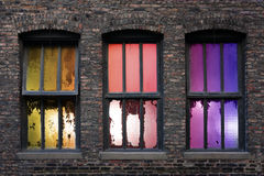 Windows of Opportunity. 3 old weathered windows with backlight during sunset Royalty Free Stock Image