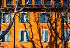 Windows of the orange building - architecture detail in Verona, Italy stock photography