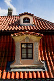 Windows on orange roofs in Prague Royalty Free Stock Image