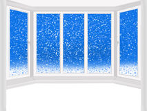 Windows overlooking the snowing Stock Photography