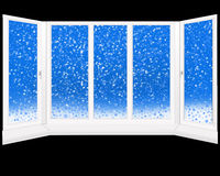 Windows overlooking the snowing isolated on black Royalty Free Stock Images