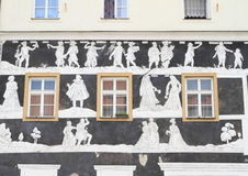Windows with painting on wall. Windows with black and white graffito painting on wall in Mikulov (Czech Republic Stock Photography