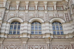 Windows with painting on wall. Windows with brown and white graffito painting on wall of school building in Prague (Czech Republic Royalty Free Stock Photos