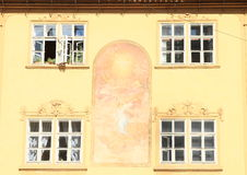 Windows with painting on wall. Windows with graffito painting on wall in Prague (Czech Republic Royalty Free Stock Images