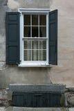Windows, pared de piedra, obturadores negros Imágenes de archivo libres de regalías