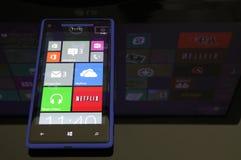 Windows Phone 8 with Windows 8 reflection. Windows phone 8 with Windows 8 in the reflection Stock Photography