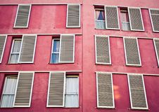 Windows on the pink wall Royalty Free Stock Photo