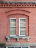 Windows in a red brick wall. Two windows in a red brick wall Royalty Free Stock Photography