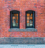 Windows in a red brick wall Royalty Free Stock Photography