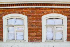 Windows in red brick wall Royalty Free Stock Images