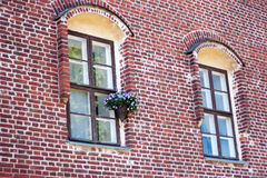 Windows in a red brick wall. Two windows in a red brick wall Royalty Free Stock Photos