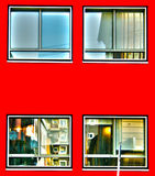 Windows on red facade Royalty Free Stock Image