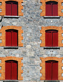 Windows with red shutters Royalty Free Stock Photography