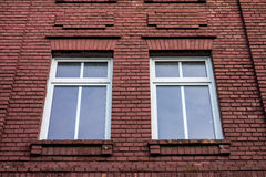 Windows in a red wall Royalty Free Stock Photography