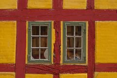 Windows in red and yellow building