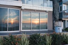 Sunset reflecting in windows on Pacific Beach Stock Image