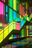 Windows reflection at congres center in Montreal. MONTREAL, CANADA - September 14, 2017: Colourful glass panels and stairs in Palais des congres de Montreal Royalty Free Stock Photos
