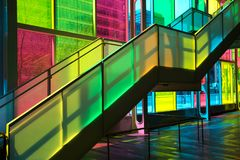 Windows reflection at congres center in Montreal. MONTREAL, CANADA - September 14, 2017: Colourful glass panels and stairs in Palais des congres de Montreal Royalty Free Stock Images