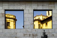 Windows and reflections on facade of building Stock Images