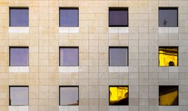 Windows and reflections on facade of building Royalty Free Stock Photos