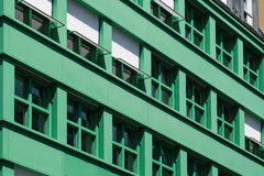 Windows on residential building exterior -  green house facade Royalty Free Stock Image
