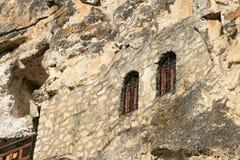 Windows of rock monastery Stock Photos