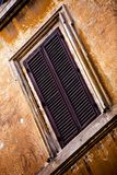 Windows of Rome City. Window on old orange wall in Rome, Italy Stock Photography