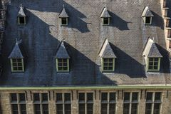 Windows on the roof of an old medieval house Stock Image
