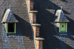 Windows on the roof of an old medieval house Stock Images