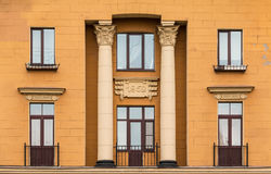 Windows in a row and balconies on facade of apartment building Royalty Free Stock Photography