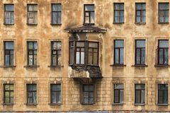Windows in a row and bay window on facade of apartment building Royalty Free Stock Photography