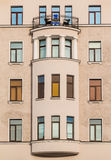 Windows in a row and bay window on facade of apartment building Stock Image