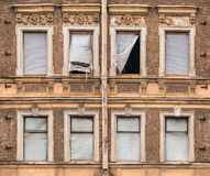 Windows in a row on facade of abandoned building Royalty Free Stock Image
