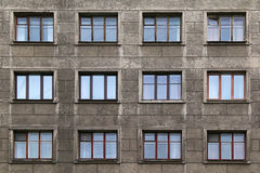 Windows in a row on facade of apartment building. Many windows in row on facade of urban apartment building front view, St. Petersburg, Russia Royalty Free Stock Photography