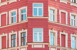 Windows in a row on facade of apartment building. Several windows in row on corner of facade of urban apartment building front view, St. Petersburg, Russia Stock Image