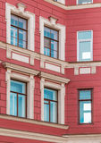 Windows in a row on facade of apartment building. Several windows in row on corner of facade of urban apartment building front view, St. Petersburg, Russia Stock Images