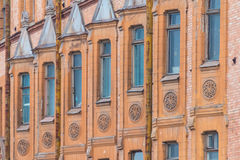 Windows in a row on facade of apartment building. Several windows in row on facade of urban apartment building angle view, St. Petersburg, Russia Stock Photography
