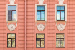 Windows in a row on facade of apartment building. Several windows in row on facade of urban apartment building front view, St. Petersburg, Russia Stock Photography