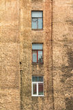 Windows in a row on facade of apartment building. Several windows in row on facade of urban apartment building front view, St. Petersburg, Russia Royalty Free Stock Images