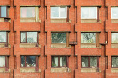 Windows in a row on facade of apartment building. Several windows in row on facade of urban apartment building front view, St. Petersburg, Russia Royalty Free Stock Photos
