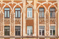 Windows in a row on facade of apartment building. Several windows in row on facade of urban apartment building front view, St. Petersburg, Russia Stock Images
