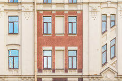 Windows in a row on facade of apartment building. Several windows in row on facade of urban apartment building front view, St. Petersburg, Russia Stock Photos