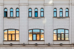 Windows in a row on facade of building. Several windows in row on facade of urban building front view, St. Petersburg, Russia Royalty Free Stock Image